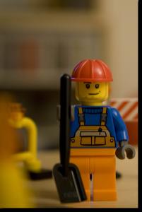 Lego Work holding a shovel.