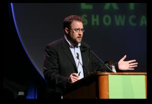 Clay Johnson speaks at a podium