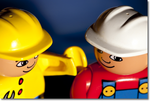 Two lego workers looking convivial