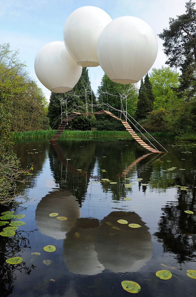 A bridge supported by balloons.