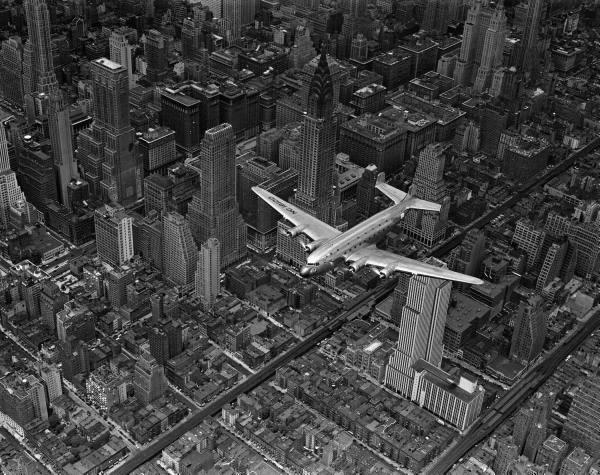 DC-4 over Manhattan, 1939.